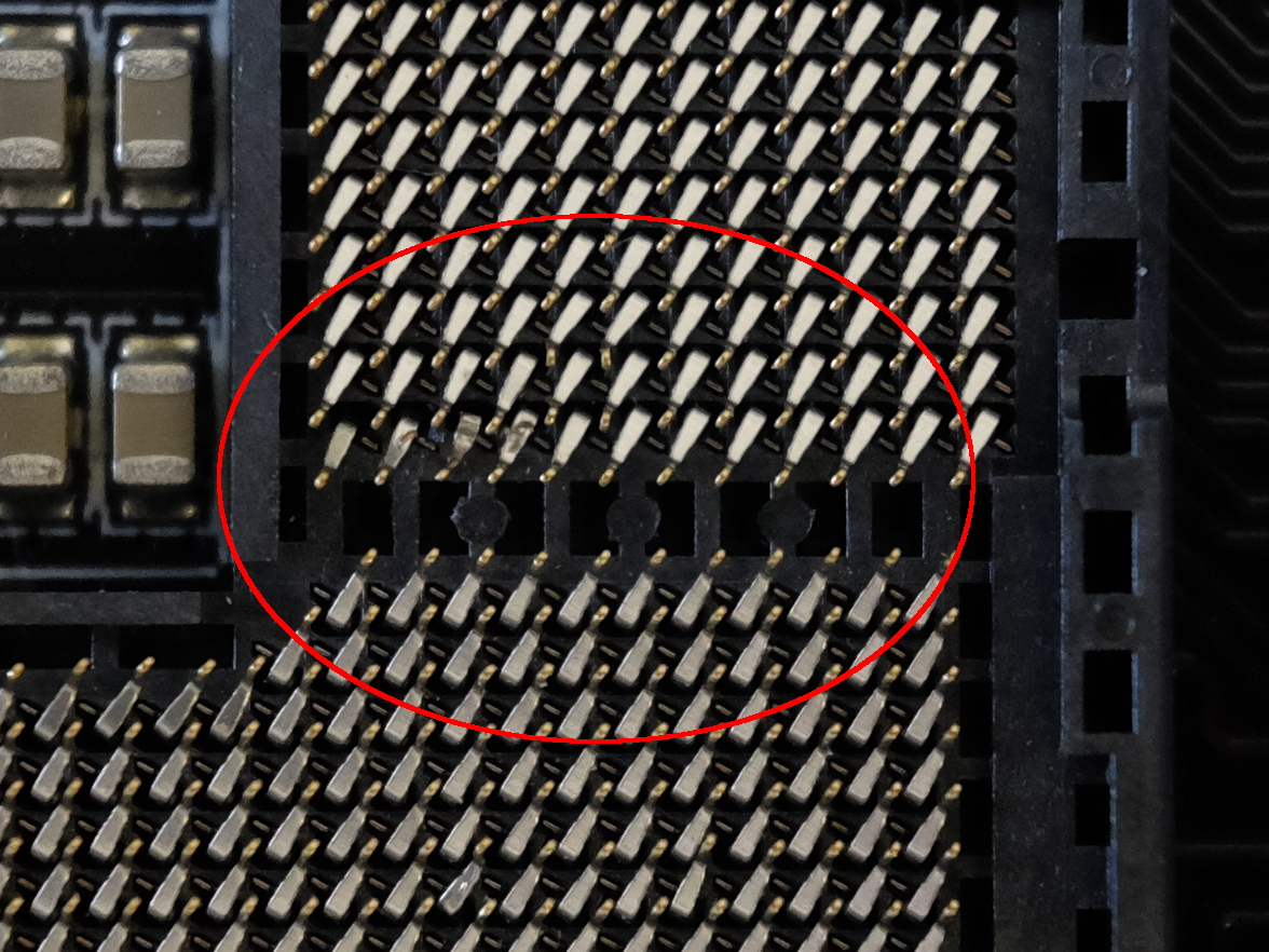 Motherboard CPU-socket with bent pins: I've tried to repair, will it
